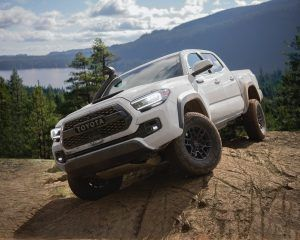 2020 Tacoma TRD Pro in super white parked on a big rock