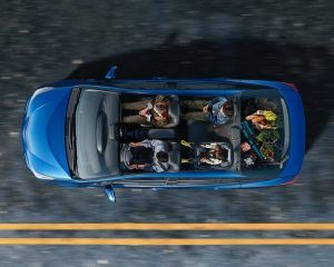 Overhead view of the inside of a 2021 Toyota Prius with parents driving and kids and cargo in the back