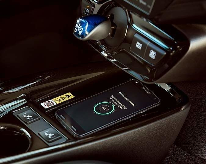 Close-up of phone getting charged in the Prius wireless charging station