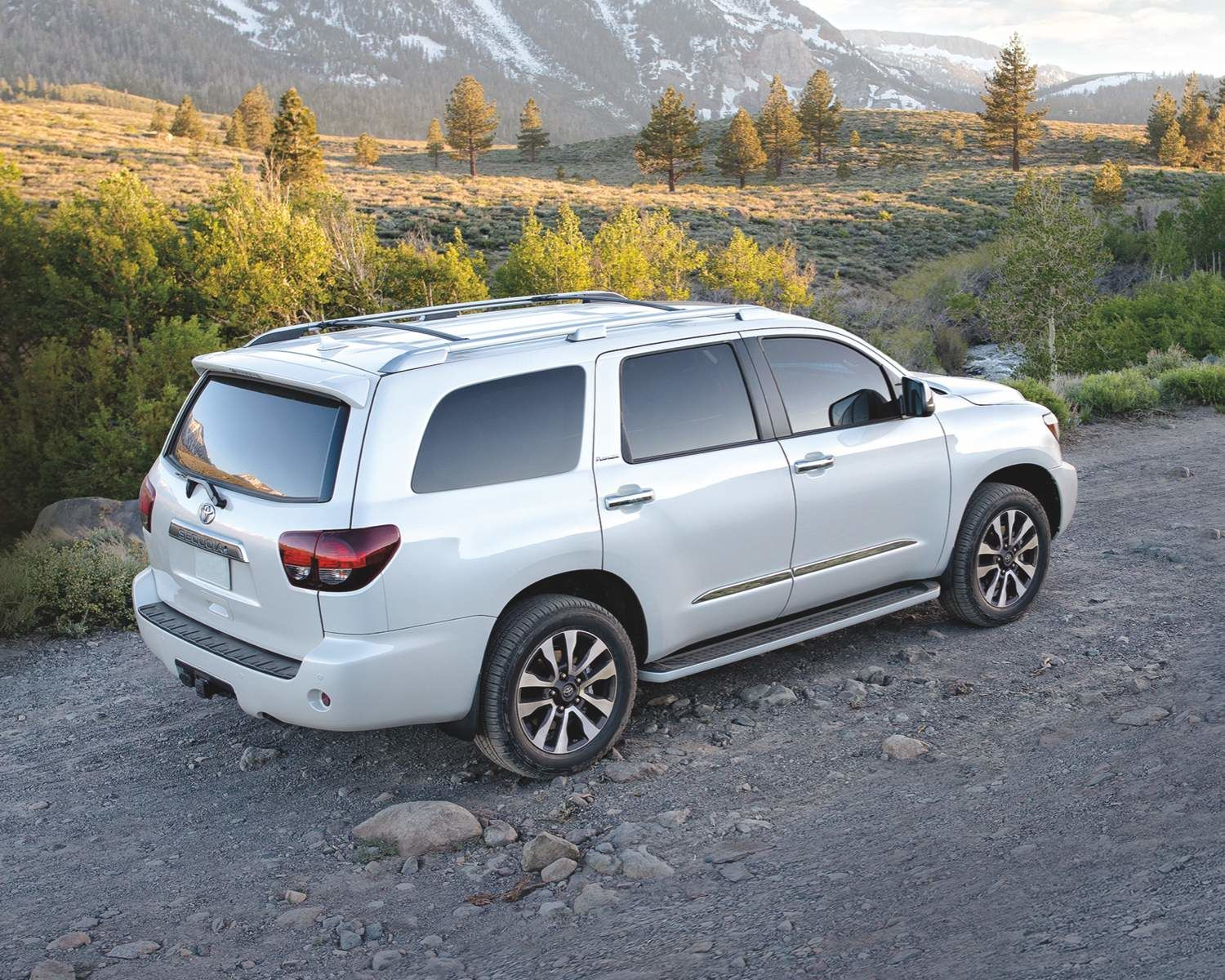 Rear side view of Toyota Sequoia on a gravel road